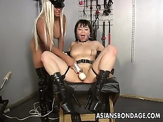 Blonde babe dominates the slut with a fuck machine
