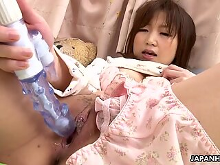 Adorable Asian babe toy fucking her soaking wet cunt