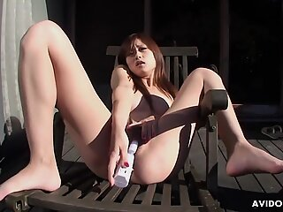 Dirty minded Asian girl Chiaki dildos her hairy love tunnel